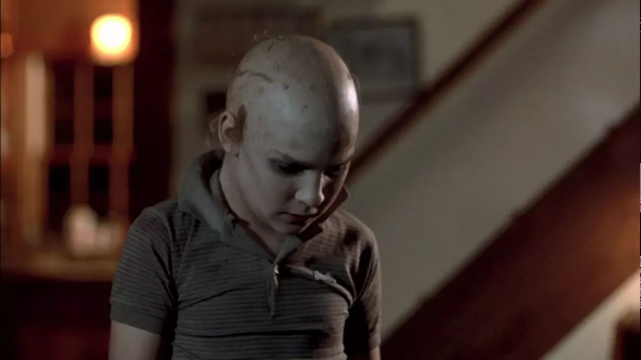 Tommy (Corey Feldman) shaves his head to confuse Jason.
